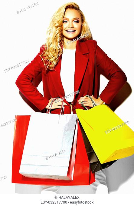 portrait of beautiful cute happy sweet surprised blonde woman girl holding in her hands big shopping colorful bags in hipster red clothes isolated on white