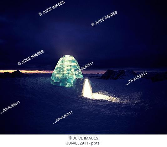 Illuminated igloo at night