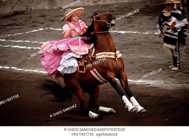 A escaramuza rides her horse before competing in an Escaramuza in the Lienzo Charros del Pedregal, Mexico City, Sunday, March16, 2013