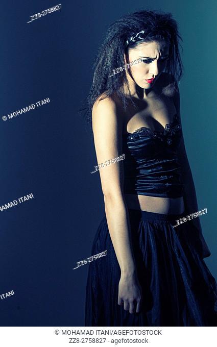 Upset woman in corset looking away