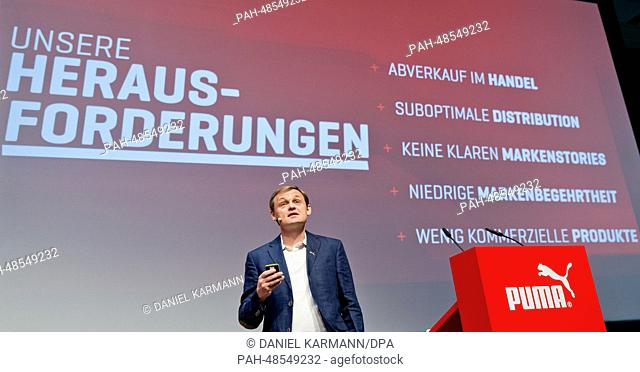 CEO of Puma SE, Bjoern Gulden, delivers a speech at the annual general meeting of Puma SE in Herzogenaurach, Germany, 13 May 2014