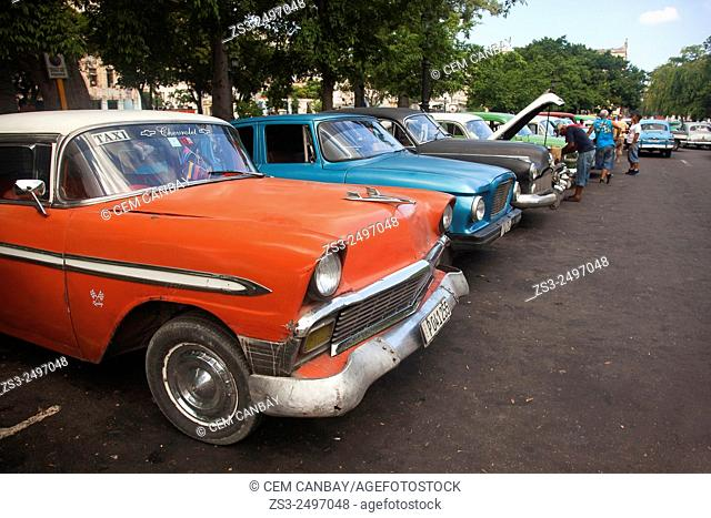 Old American cars used as taxi at the parking lot in Central Havana, Cuba, West Indies, Central America