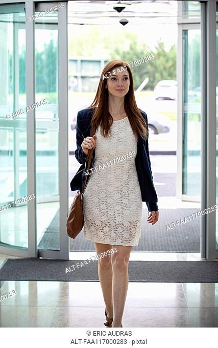 Woman entering in hotel