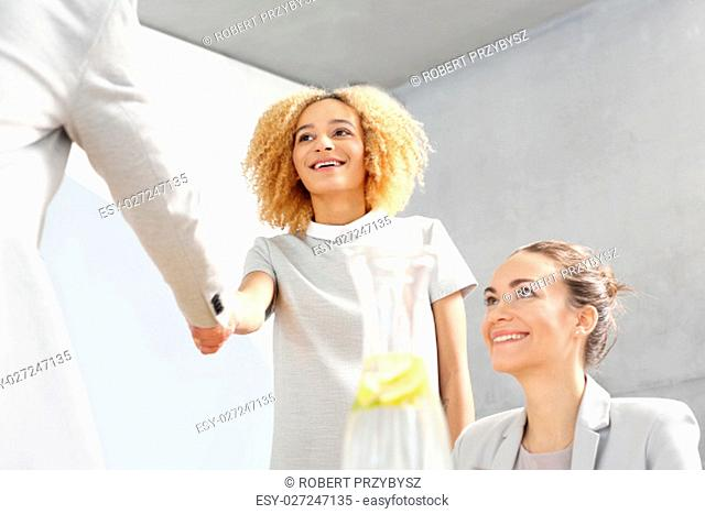 congratulations. businesswoman welcoming a new employee in the company