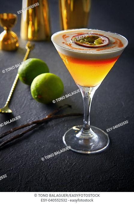 Mango cocktail with lemon and passion fruit maracuya