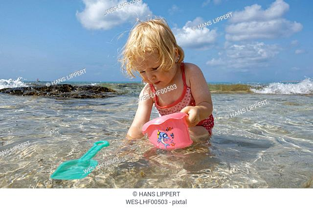 Little girl playing in the sea