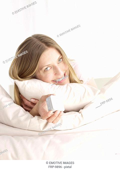 Smiling woman in bed
