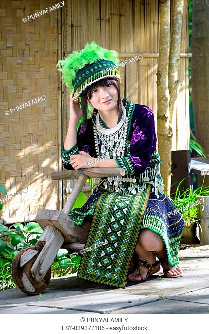 cute asian young girl in beautiful hill tribe (HMONG) costume of northern thailand