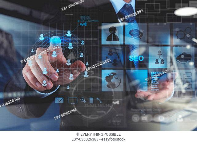 double exposure of businessman hand working with new modern computer and business strategy as concept