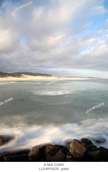 High angle view of rocky shoreline - long exposure. Port Alfred, Eastern Cape Province, South Africa