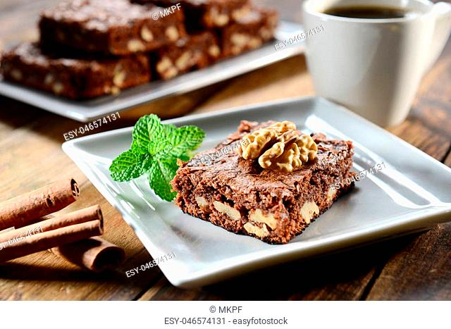 Chocolate Brownie peace with walnut on top in square plate
