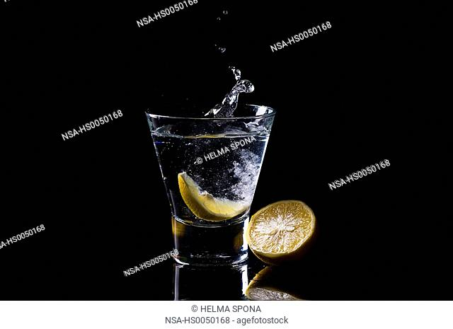 Glass of water on a black background