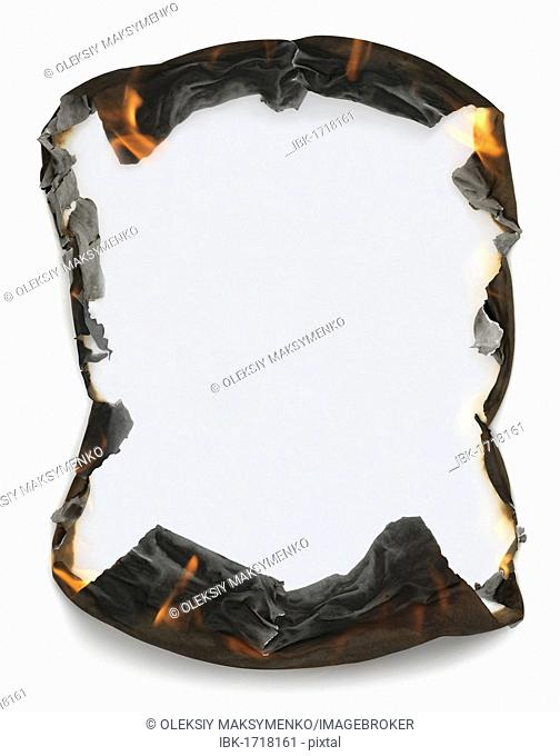 Sheet of blank paper with burning edges making a frame