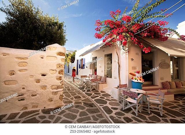 Woman walking through the alleys of Parikia, Paros, Cyclades Islands, Greek Islands, Greece, Europe