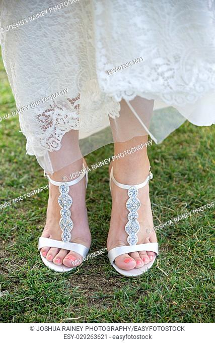 Bride wedding shoes on grass at a golf course wedding in Oregon