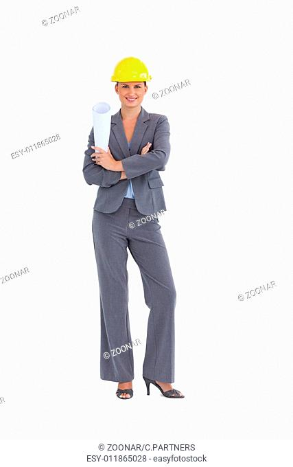Smiling female architect with folded arms