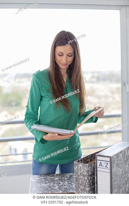 Pretty brunette woman checking her finance at home