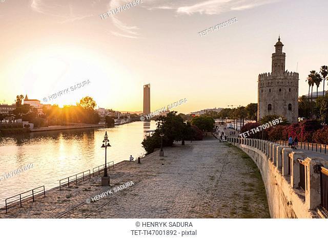 Spain, Andalusia, Seville, Golden Tower against sunrise