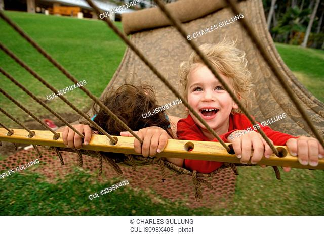 Boy and girl in hammock
