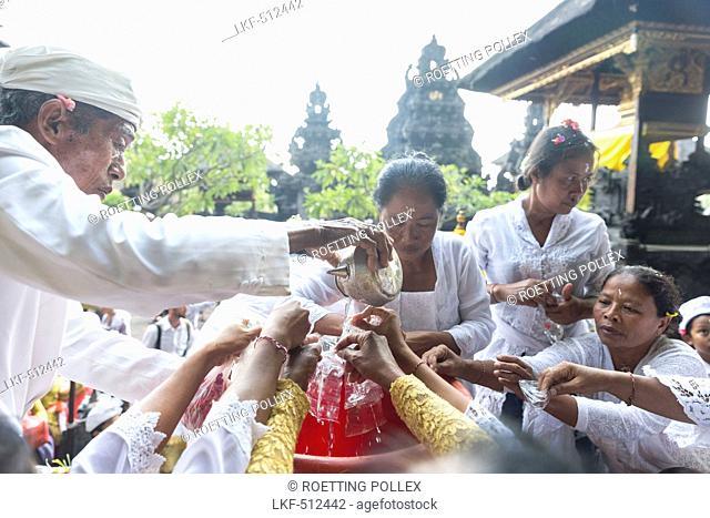 Balinese people praying, Odalan, Pura Goa Lawah, Padangbai, Bali, Indonesia