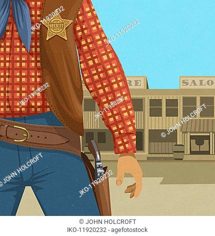 Close up of Wild West sheriff with hand ready to draw gun