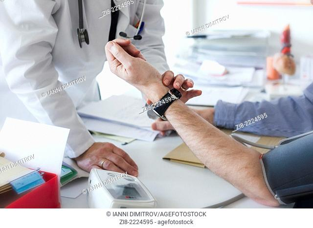 Doctor examines male patient