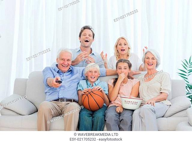 Extended family watching the television