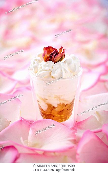 Jam with cream, meringue and rose petals