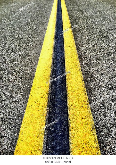 Double Yellow Road Lines on asphalt (mobile image)