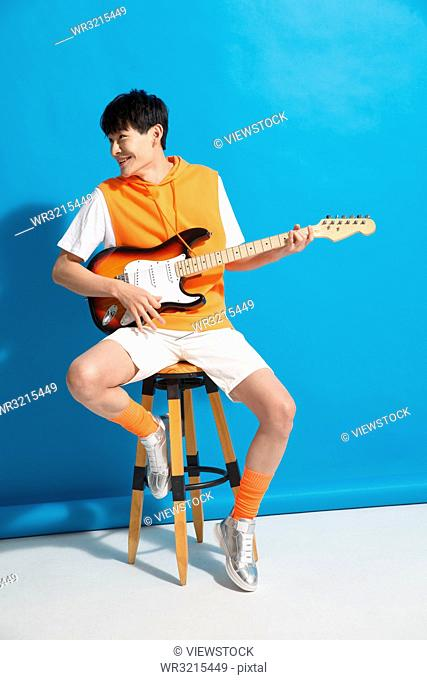 Young men play the guitar