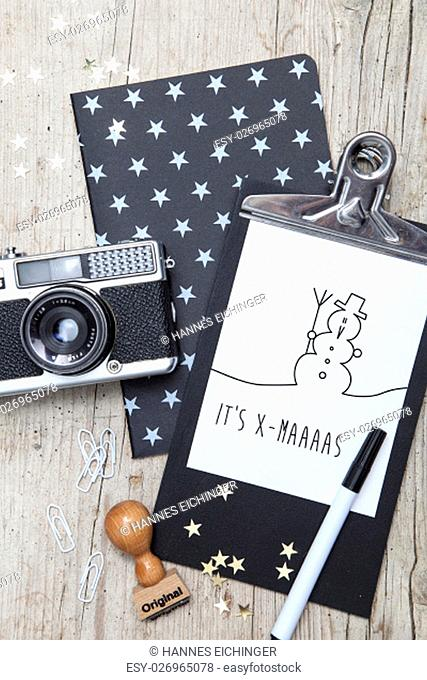 creative christmas card with an old photo camera