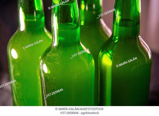 Four bottles of cider, close view. Asturias, Spain