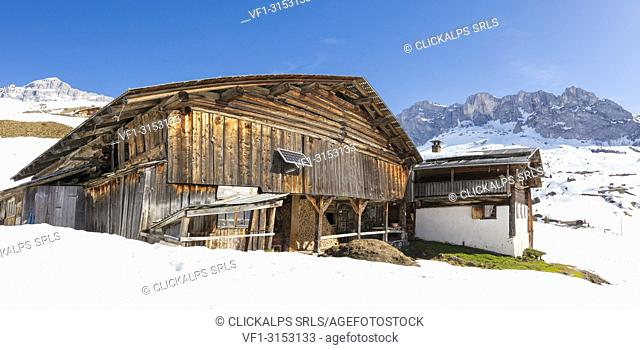 Panoramic of wood hut surrounded by snow, Partnun, Prattigau, Davos, canton of Graubunden, Switzerland