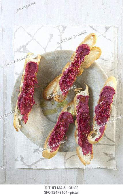Cashew and beetroot hummus on crostini