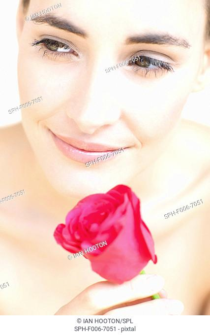 MODEL RELEASED. Woman with rose