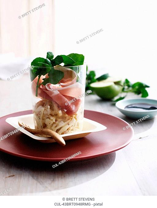 Proscuitto in glass with herbs