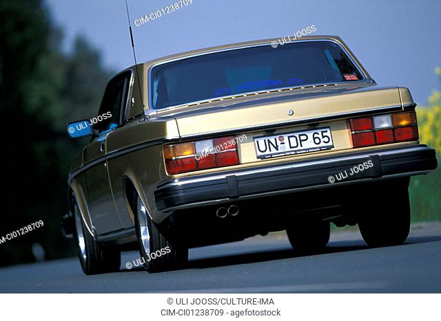 Car, Volvo 262 Coupe, Coupé, gold, model year 1977-1981 this car model year 1978, old car, 1970s, seventies, 1980s, eighties, driving, diagonal back, back view