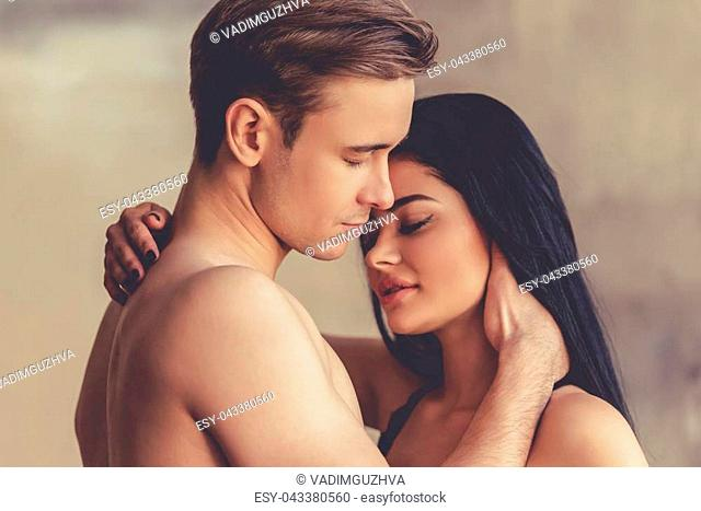Sensual young couple is touching each other tenderly