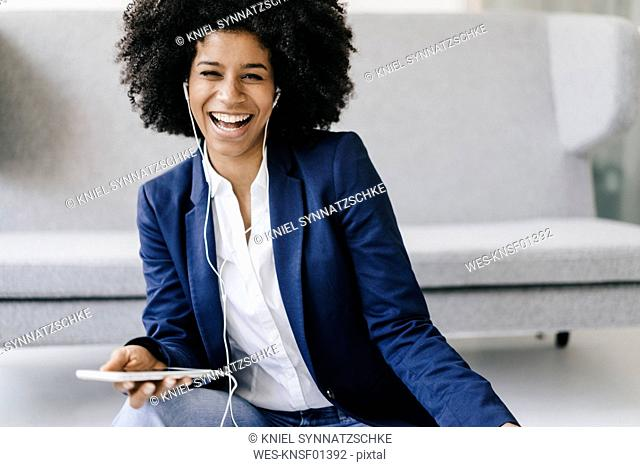 Young businesswoman using smartphone with headset