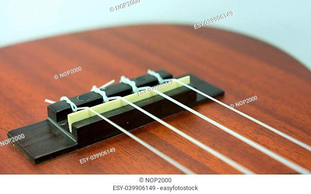 Ukulele nylon string bridge