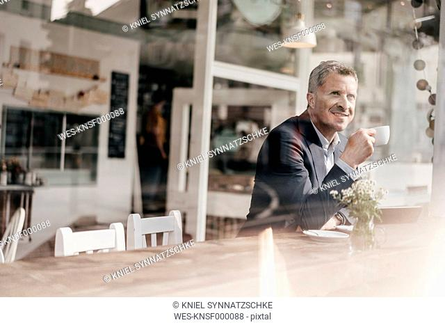 Businessman in cafe drinking coffee