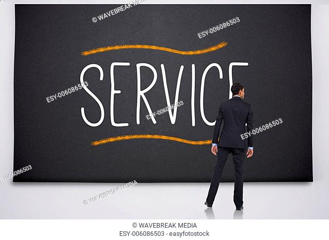 Businessman reading the word service