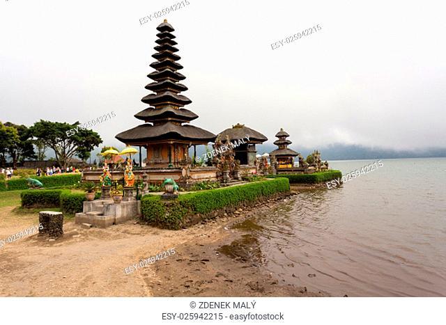 Most famous Pura Ulun Danu water temple on a lake Beratan. Bali, sunny evening with mist