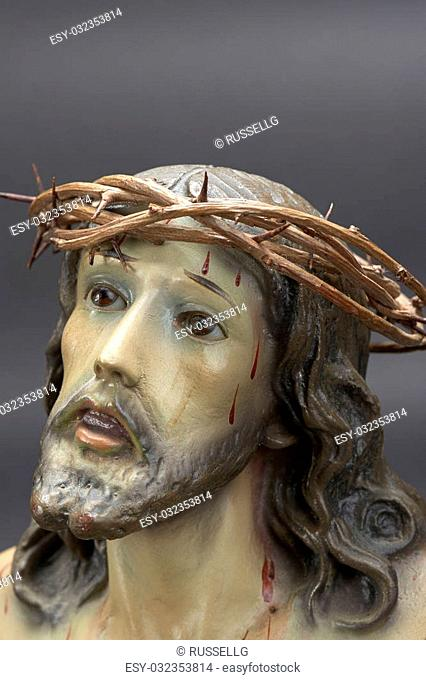 Jesus Christ ornament depicting Christ with crown of thorns and bleeding