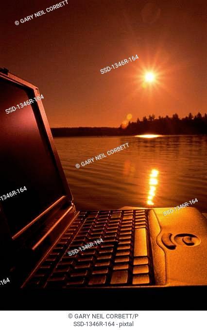 Close-up of a laptop outdoors