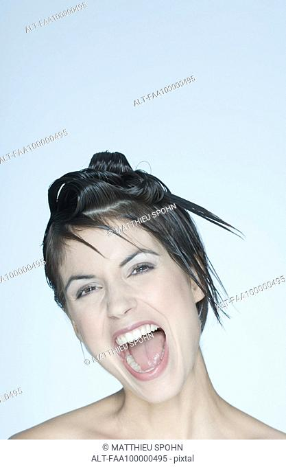 Woman with spiky hairstyle, mouth open, portrait