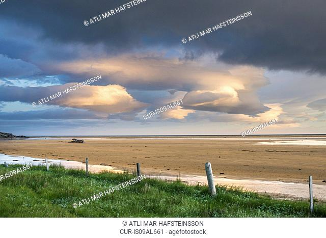 View of storm clouds and beach, Raudasandur, west fjords, Snaefellsnes, Iceland