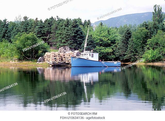 Cape Breton, Nova Scotia, NS, Canada, Blue lobster boat in Dingwall in Cape Breton. Lobster traps on dock