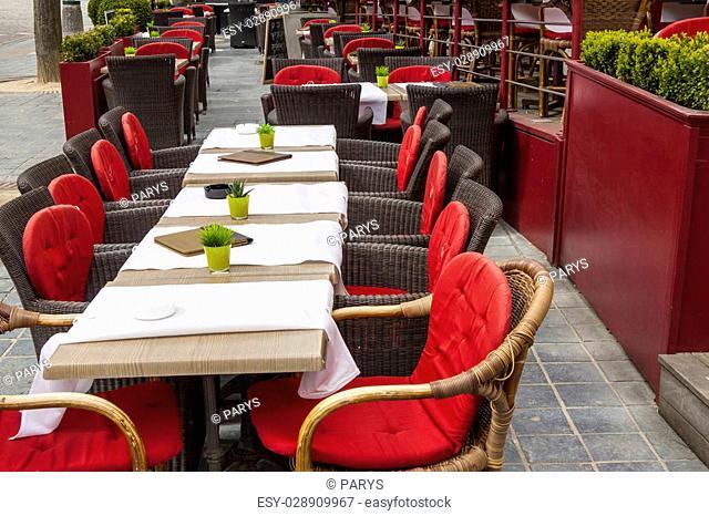 Tables in outdoor restaurant - old town of Brugge, Belgium
