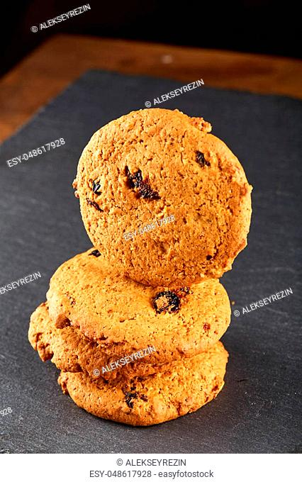 Freshly baked chocolate chips cookies isolated on black background, macro, close-up